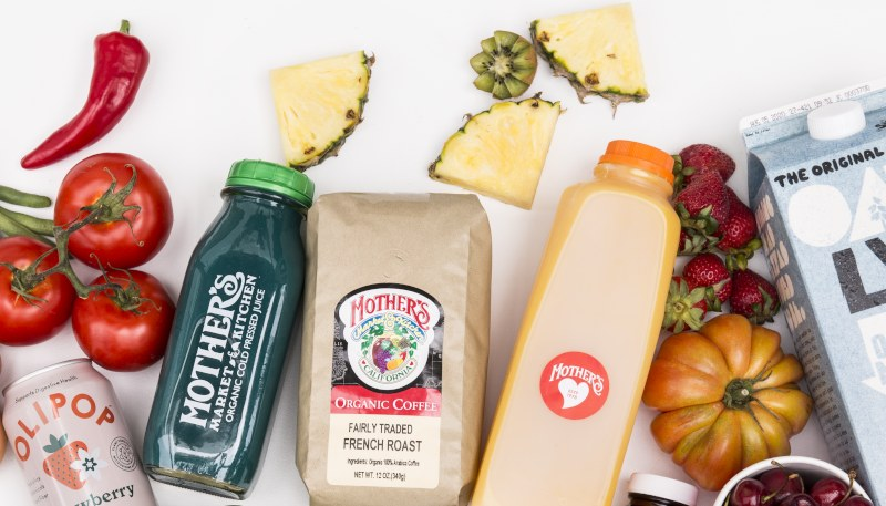 A selection of Mother's products, from produce and juices to a bag coffee